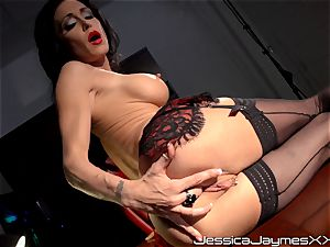 insane black-haired Jessica Jaymes fingers her jummy coochie pie in her office