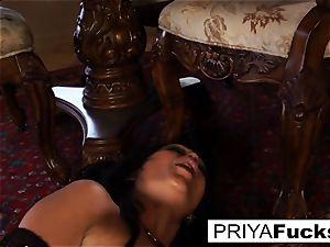 Priya Rai rides a sybian saddle to a massive ejaculation