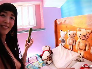asian star Marica Hase plays with candy cock