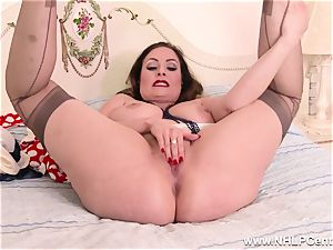 huge-titted dark haired drains off in tan nylons after striptease